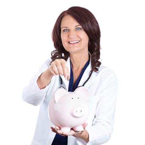 A lady adding money to a piggy bank