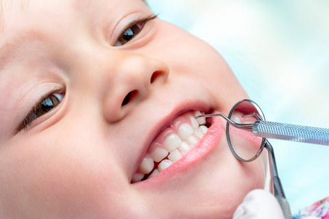 A child getting checked at the dentist