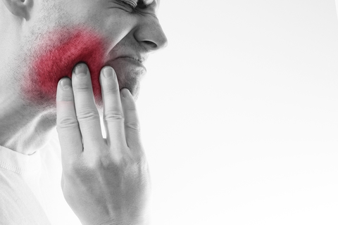 Man in pain from tooth abscess