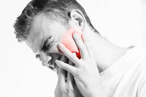 A man experience a lot of pain from teeth that are sensitive