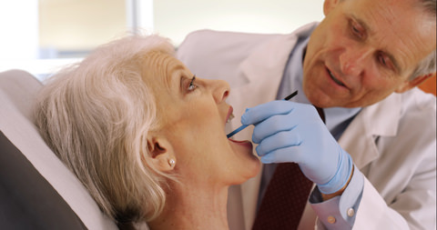 A lady getting dentures fitted
