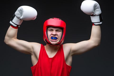 A man using a mouthguard while boxing