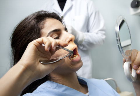 Tooth extraction at the dentist