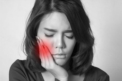 A lady experiencing a toothache