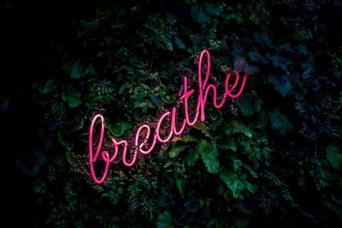 Breathe written in pink