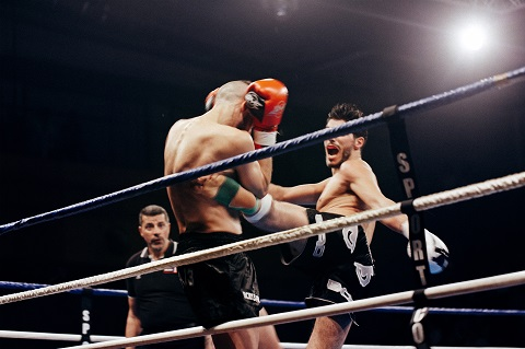 Two man fighting in a ring