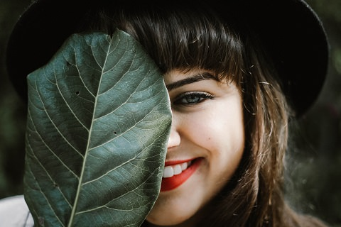 A woman slightly showing her smile