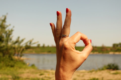 A lady giving the the A okay sign