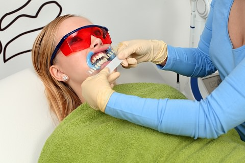 Professional teeth whitening by a dentist