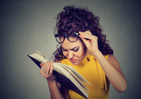 A lady reading instructions