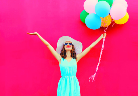 A lady that's happy with balloons