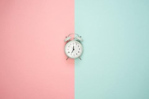 A clock on a coloured wall
