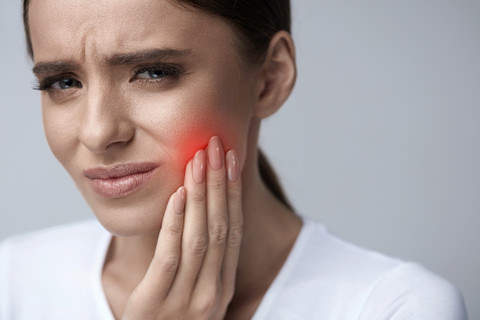 A lady with an infected tooth