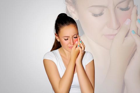 A woman with sensitive teeth