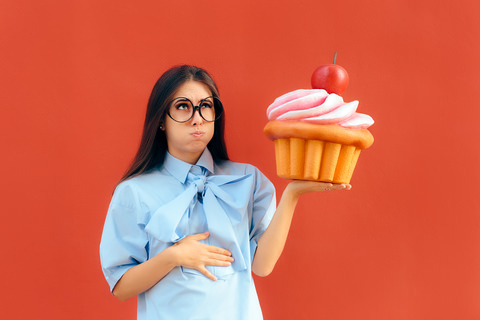 A woman with a cupcake