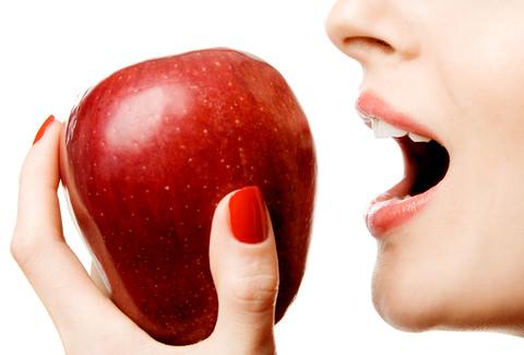 Biting down hard on an apple