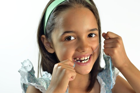 A girl flossing
