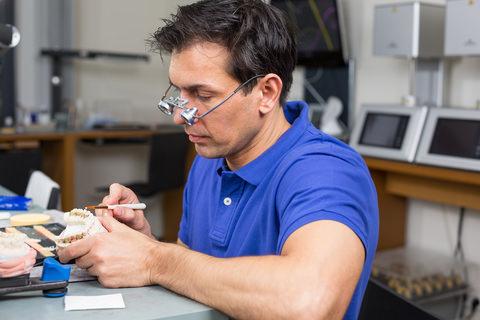 A dental technician in a dental lab