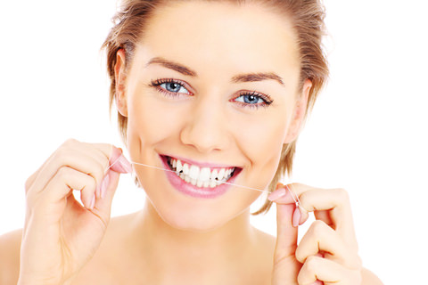 A woman flossing
