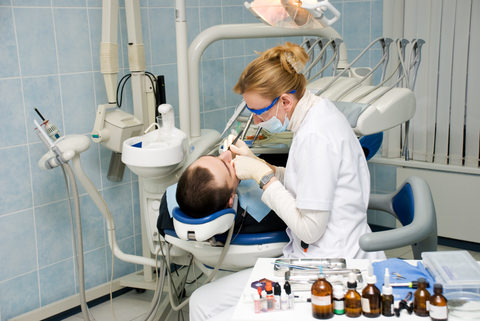 A dentist treating her patient