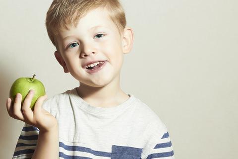 A boy with an apple