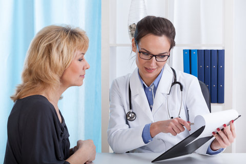 A doctor showing a patient results from a test