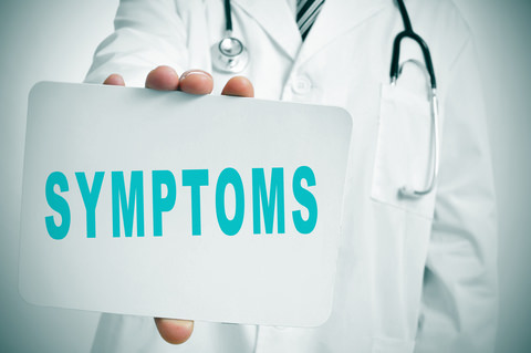 a Doctor with a card saying symptoms