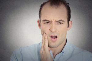 A man with sensitive teeth