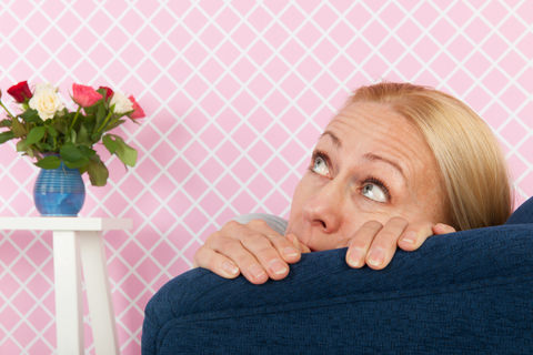 A woman worried about her bad breath