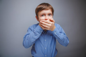 Feature image of a boy suffering from morning breath