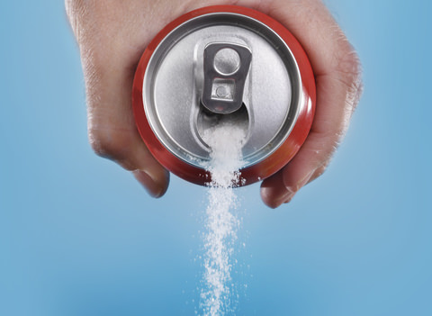 Sugar pouring out of a can