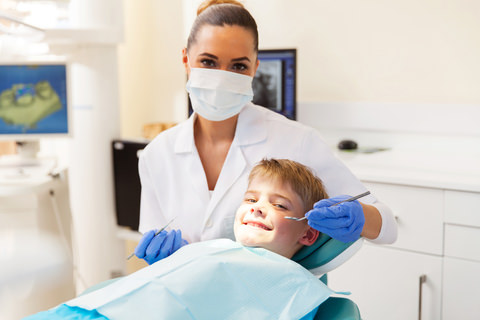 A boy visiting his dentist