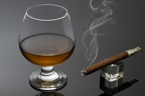 A glass of spirits and a cigar