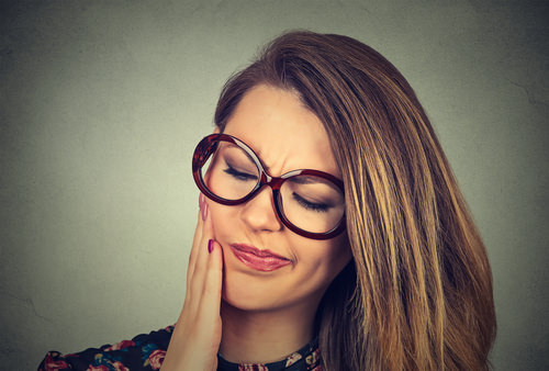 A lady with Tooth Pain after root canal