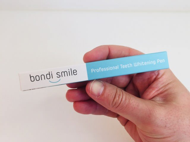 holding the bondi smile teeth whitening pen