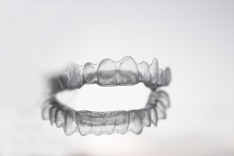 Invisalign aligner on a clear background