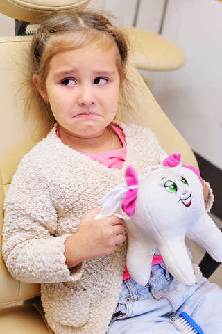 A child not happy at the dentist