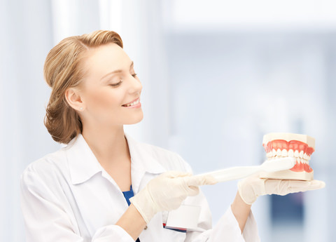 A dental Hygienist showing how to brush