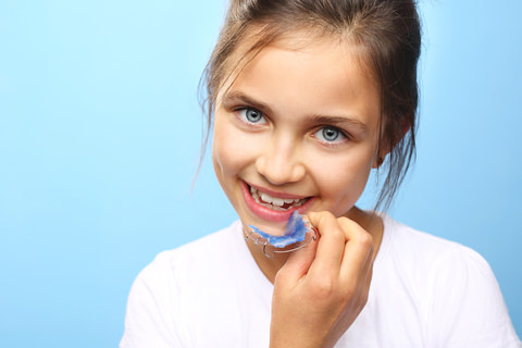 A girl with a dental plate