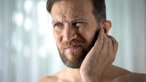 A man with a earache
