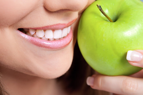 A lady with an apple - A good healthy snack
