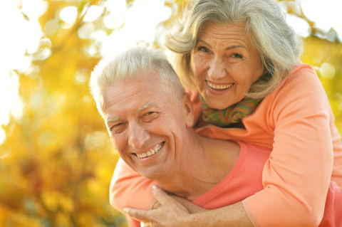 Seniors enjoying life with good teeth