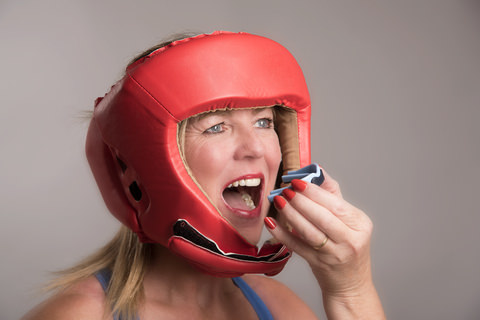 A woman wearing a mouthguard for a sporting event