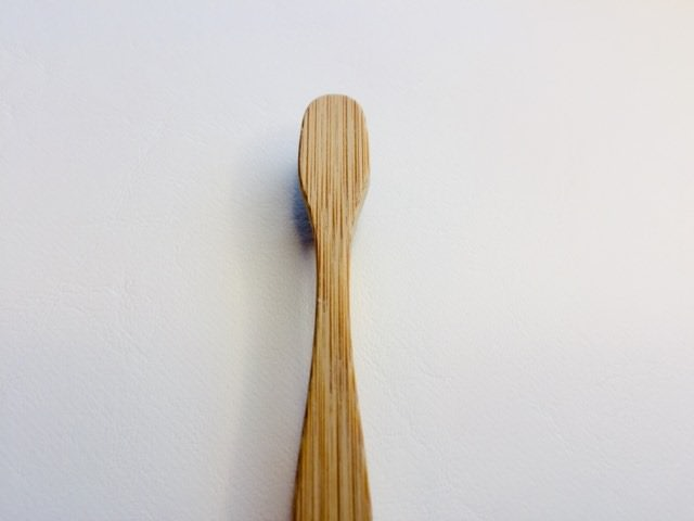Looking at the back of the head of the colgate bamboo charcoal toothbrush
