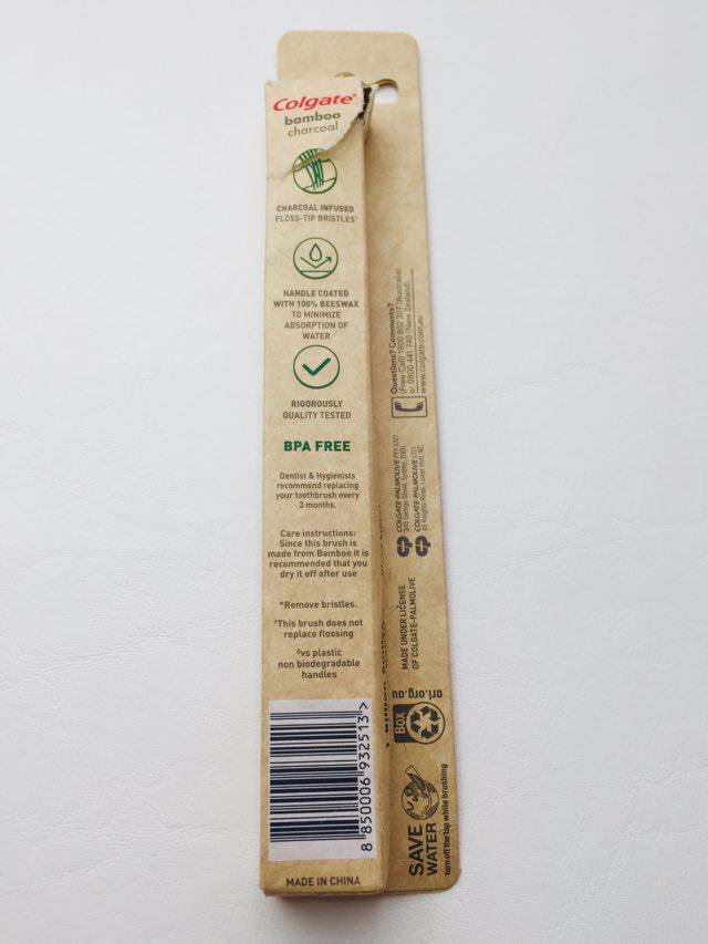 Details on the back of the colgate bamboo charcoal toothbrush