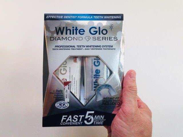 Holding the White GLO Diamond Series Whitening System