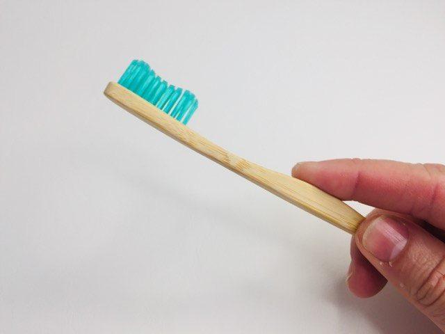 Holding and feeling the bamkiki bamboo toothbrush