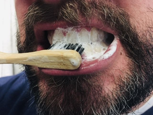 testing out the kappi bamboo toothbrush
