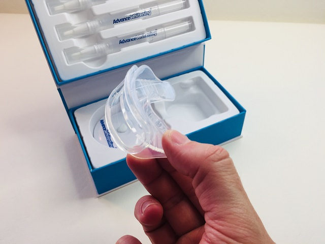 Holding the Advance Whitening moulded mouth tray