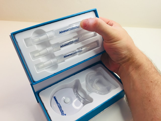 Securing the Advance Whitening Pens into place